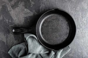 how to clean crud off a cast iron skillet